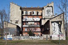 Graffiti house. Close-up of occupied house with graffiti Stock Image