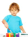 Occupied little boy painting Royalty Free Stock Images