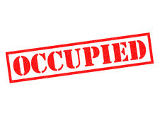OCCUPIED Rubber Stamp Stock Images