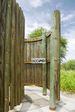 Occupied sign in outdoor toilet in the Central Kalahari Game Res Royalty Free Stock Images