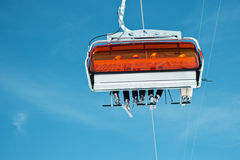 Occupied ski lift Stock Images