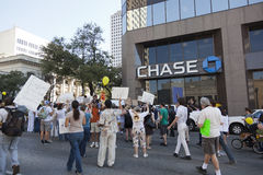 Occupy Austin - October 15 Protest March. AUSTIN, TX - OCTOBER 15: An unidentified crowd of protestors gathers outside the Chase Bank Tower during the 'Occupy stock images