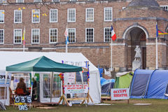 Occupy Bristol Encampment. BRISTOL, ENGLAND - NOVEMBER 18: The Occupy Bristol camp on College Green outside the Cathedral and Council offices in Bristol, England Royalty Free Stock Image