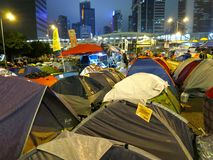 Occupy Central Tents. HONG KONG, DEC. 3, 2014: Pro-democracy protesters set up tents on the street in downtown Hong Kong, blocking the road, as they demand the royalty free stock image
