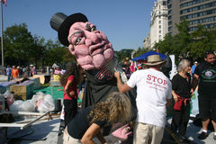 Occupy DC activists prepare giant puppet. DC - OCTOBER 9: Activists prepare for a puppet show at the Occupy DC demonstration in Freedom Plaza, Washington, DC Royalty Free Stock Photography