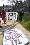 Occupy Exeter activist hold up a banner Stock Photo