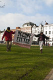 Occupy Exeter activist hold up an Occupy Exeter ba Stock Image