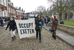 Occupy Exeter activist march out of the grounds Stock Photos