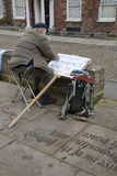 Occupy Exeter activist prepares a sign Royalty Free Stock Photo