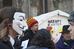 Occupy Exeter activist wearing Guy Fawkes mask Royalty Free Stock Image