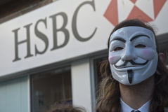 Occupy Exeter activist wearing Guy Fawkes mask. Occupy Exeter activist wearing a Guy Fawkes mask campaigning outside the Exeter branch of HSBC bank Stock Photos