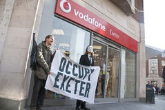 Occupy Exeter activists campaign Vodaphone. Occupy Exeter activists campaign outside Exeter branch of Vodafone Royalty Free Stock Image
