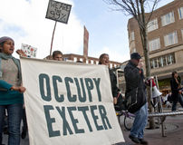 Occupy Exeter supporters and participants march th Royalty Free Stock Photos