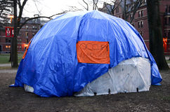 Occupy harvard university. Blue occupy harvard tent. Occupy Harvard was a student demonstration at Harvard University identifying itself with the global Occupy Royalty Free Stock Photo