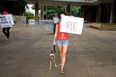 Occupy Honolulu/anti-APEC Protest-14. Woman and dog holding anti- APEC sign. Members of Occupy Honolulu gathered at an Occupy movement and anti-APEC protest Royalty Free Stock Photography