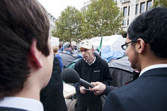 Occupy London protesters answering to public Royalty Free Stock Photography