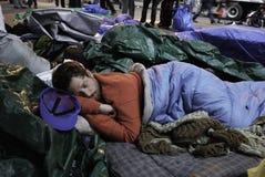 Occupy Wall Street Protestor. 2011 Occupy Wall Street at Zuccotti Park.  A protestor takes a sleep break Stock Photos