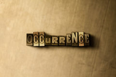 OCCURRENCE - close-up of grungy vintage typeset word on metal backdrop Stock Photos