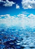 Ocean. Blue ocean and sky with cumulus clouds Royalty Free Stock Photos