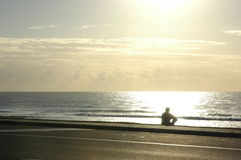 Ocean. A man silhouetted against the sun rise Royalty Free Stock Photo