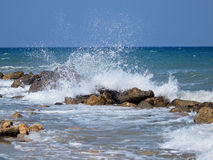 Ocean. Splash blue ocean with rocks Royalty Free Stock Photos