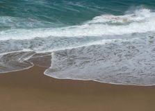 Ocean. Powerful ocean waves break onto the sand royalty free stock photography