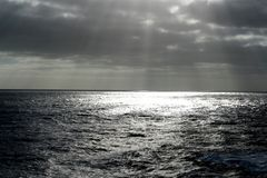 Ocean. A caribbean sunrise with sun rays over the ocean Stock Photo