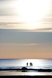 By the ocean. Three silhouettes in the blue ocean Royalty Free Stock Photo