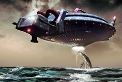 Ocean abduction. A giant UFO flies over the ocean taking off for abduction several animals and a fish-boat Stock Photography