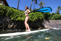 Ocean active woman. Woman on stand up paddle board Royalty Free Stock Photos