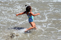 Ocean Adventures. Little girl on her own splashing in the ocean in San Diego Stock Photos