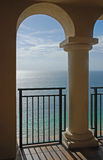 Ocean and Arches. A beautiful view of the ocean through an arches of a balcony Stock Photography