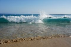 Ocean. Atlantic. Magic waves running on the beach sand Stock Photo