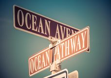 Ocean Avenue and Ocean Pathway cross signs in Ocean Grove, NJ. Retro split-tone stock photos