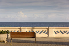 Ocean Avenue. Walled and bench on the seafront in the leisure area of Oceanica Avenue near the Farol da Barra in Salvador Royalty Free Stock Photography
