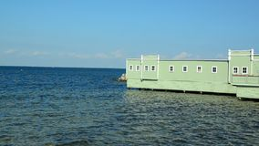 Ocean and bathhouse on a sunny day stock video footage