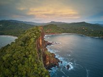 Ocean bay around rocks. Aerial drone view on sunset time Stock Images