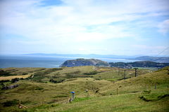 Ocean, bay, meadow. Great view, rest, relaxation, travel, sun blue sky and clouds, water, ocean, green grass meadow,cliffs Royalty Free Stock Photography