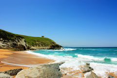 Ocean bay in Suances , Spain. View of beautiful sandy beach and azure sea in Suances, Spain royalty free stock photos
