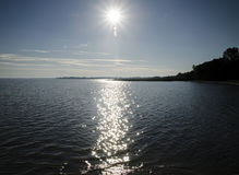 Ocean bay in sunrays Royalty Free Stock Photos