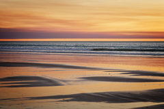 Ocean and Beach Background. At sunset Stock Images