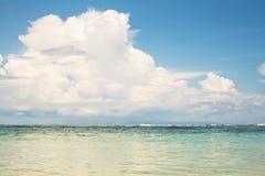Ocean beach blue sky sand sun daylight relaxation landscape view Stock Photos