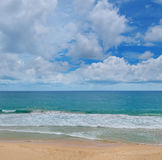 Ocean, beach and blue sky Stock Images