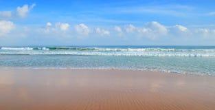 Ocean,  beach and blue sky Stock Photos