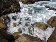 Ocean beach California  sand rock wave sky royalty free stock photos