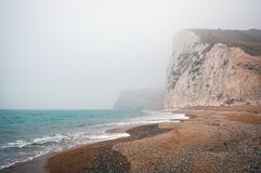 Ocean Beach with Cliffs Royalty Free Stock Photo