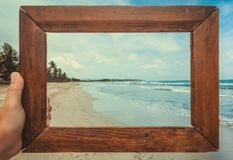 Ocean beach landscape in photoframe for memory. Tropical climate nature and fantastic view on calm blue waves. Of Sri Lanka or India stock photography