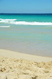 Ocean beach. Lonely white beach, turquoise water and blue sky Royalty Free Stock Photos