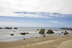 Ocean beach with rocks Stock Images