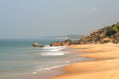 Ocean and beach with stones. Kovalam, india Stock Images